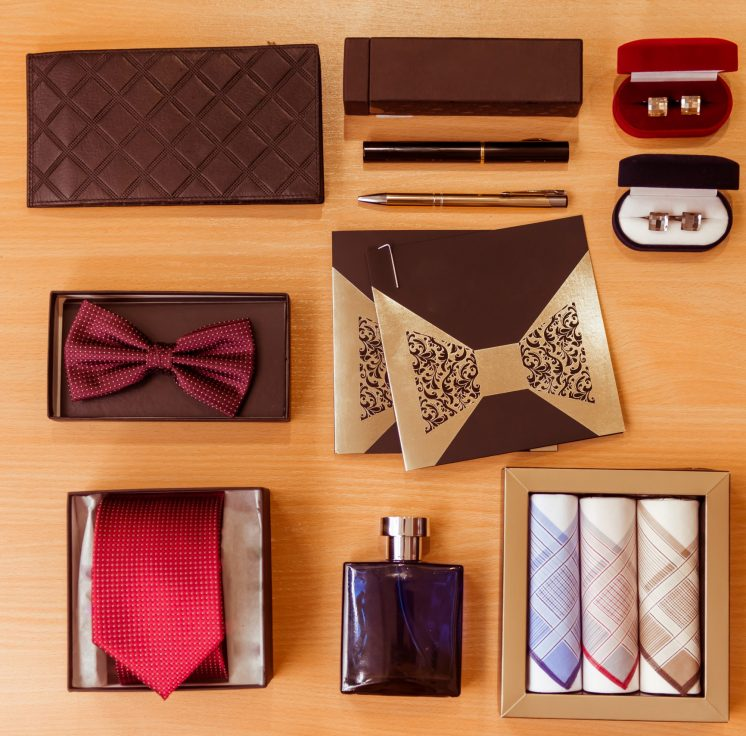 Men's assessories lying on wooden background.